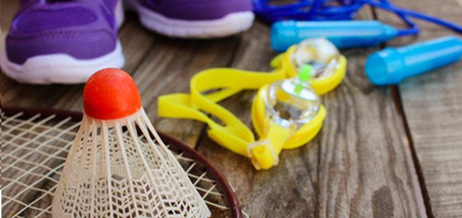 Sporting Goods Logistics - Badminton, racket, goggles, shoes, and jump rope on wood